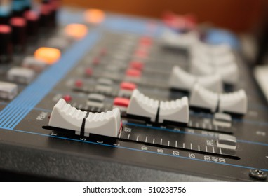 Closeup mixer in recording room. Closeup button to increase or decrease sound.