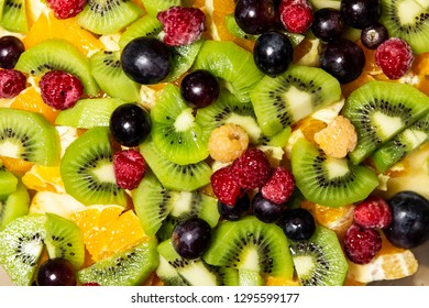 Closeup of mixture of kiwi, orange, grapefruit, raspberry and apple