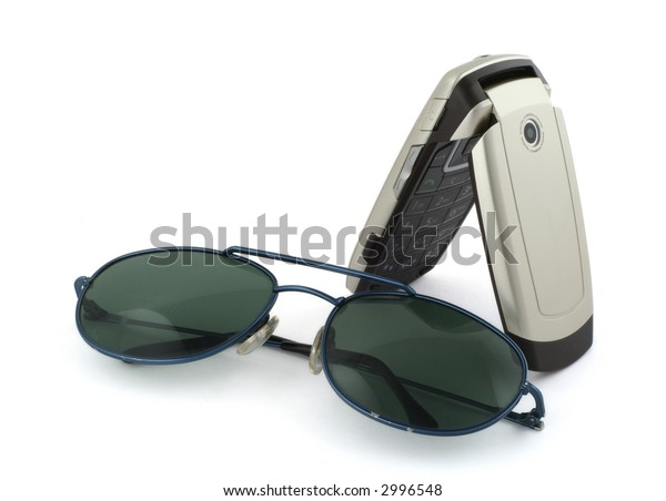 close-up of mobile phone nad sunglasses on white