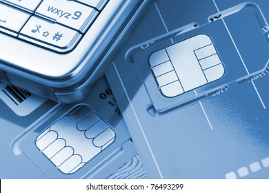 Close-up of mobile phone with sim cards. Toned in blue