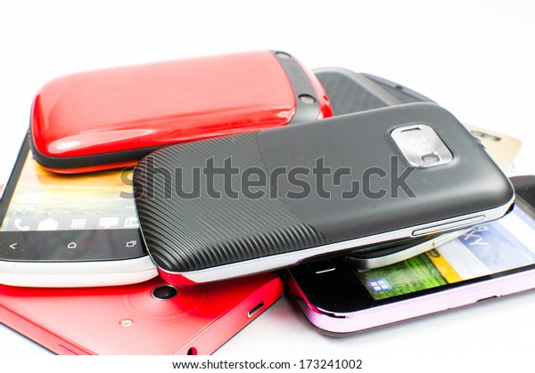 Close-up of mobile phones stacked together