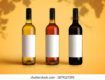 Closeup mockup of three types of wine bottles on a yellow desk and background. Empty blank paper label template to insert your brand or design
