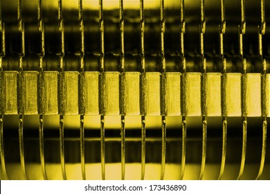 Close-up of modern computer processor cooler or radiator or heat sink in gold or yellow color