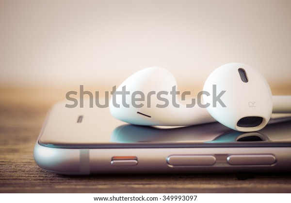 closeup modern headphone on phone media portable
