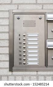 close-up of a modern nameplate with intercom doorbell