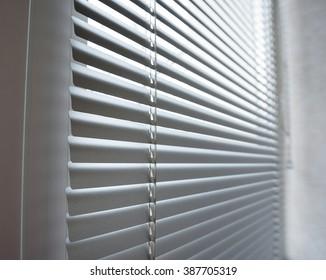 close-up modern plastic Shutter Blinds in room