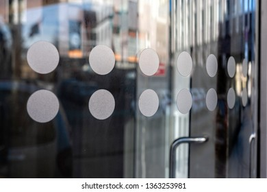 close-up of modern secured glass door fragment at corporate business building. - Image