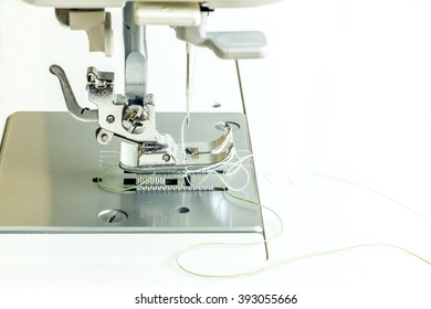 Close-up of modern sewing machine foot.