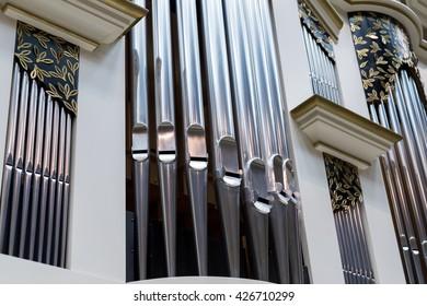 Close-up of modern steel organ pipe