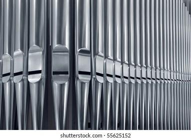 Close-up of modern steel organ pipe set horizontal