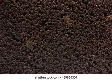 Close-up of moist chocolate brownie texture.
