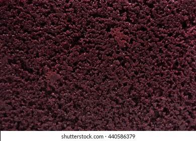 Close-up of moist red velvet cake texture.