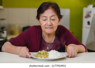 Closeup of mom's hands holding a plate, concept of homemade food