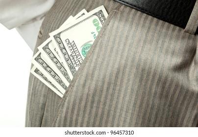 Closeup of money (dollar banknotes) in businessman's pocket