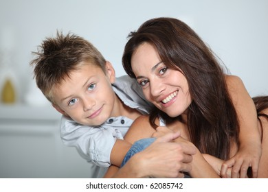 Closeup of mother and child smiling