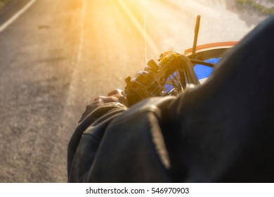 Closeup motorcycle handlebars while driving on the road