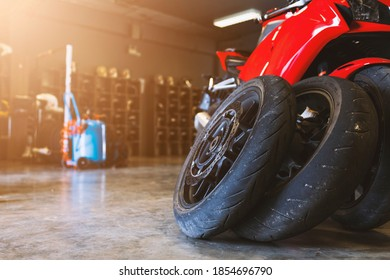 closeup motorcycle tire bigbike in garage with soft-focus and over light in the background