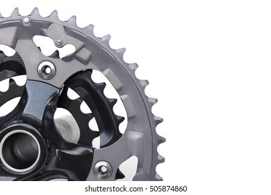 Closeup of mountain bike chain rings in crankset isolated