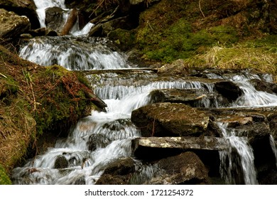 Closeup of mountain creek flowing over stones. Waterfall or cascade on small river in forest. Divoky dul, Jeseniky mountains, Czech Republic. - Shutterstock ID 1721254372