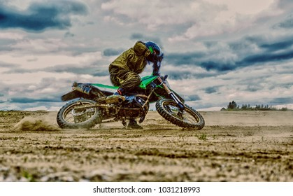 Close-up of mountain motocross race in dirt track in day time. Motocross bike in a race representing concept of speed and power in extreme man sport