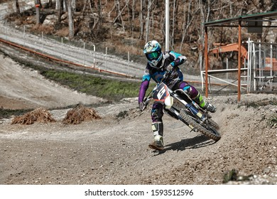 Close-up of mountain motocross race in dirt track in day time. Concept focus of during an acceleration in action sport