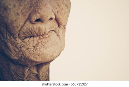 Closeup mouth of elderly woman toothless vintage with space to add text