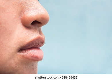 Closeup Mouth  and sweat on nose  on face  of asian woman, copy space on right side