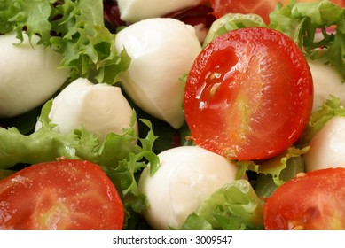 Close-up of mozzarella salad with fresh vegetables