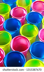 close-up of multi colored plastic cups, full frame