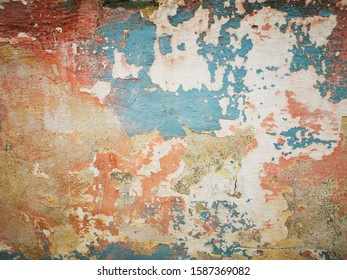 closeup of multi layers of pealing paint weathered and damaged walls