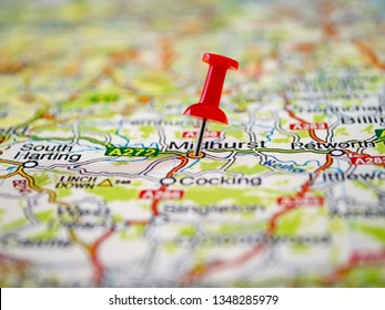 Close-up of multi-colored Map of England with a red pushpin stuck. Pins on Europe road-map for planning your travel trip. Pushpin showing the location of a destination point on a map.