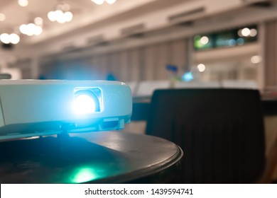 Close-up multimedia projector with blurred background with copy space, business conference,lecture in office.