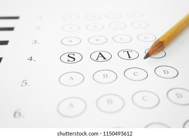 Closeup of multiple choice exam with SAT text and pencil