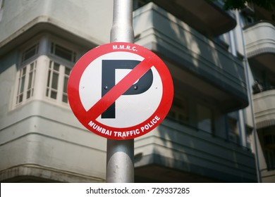 "A closeup of a Mumbai traffic police ""No Parking"" banner with the trademark logo in Churchgate, Mumbai, Maharashtra, India. Shot in October 2017."