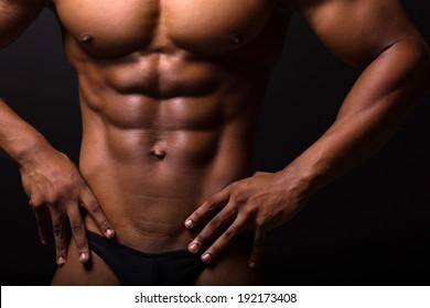 closeup of muscular african man 6 packs