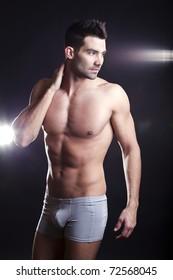 Closeup of a muscular handsome man in underwear