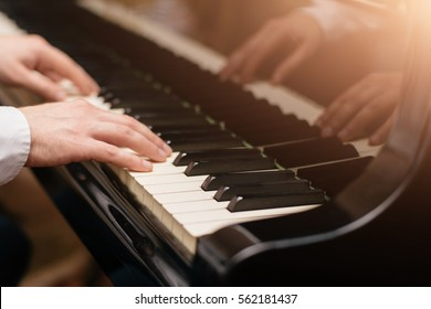 Photo of Close-up of a music performer's hand playing the piano