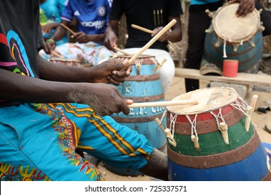 Close-up of a musician playing traditional drums on the beach in Accra, Ghana