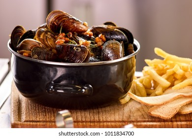 Closeup mussels in saucepan. Mussels and side dish.