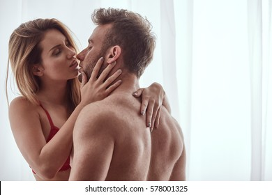 Close-up of naked lovers kissing each other with passion and love