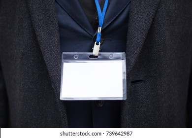 A close-up, name tag on the neck of a businessman in a jacket. Mock up.