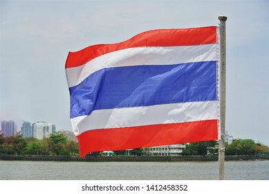 Close-up National Flag of Thailand Against River Scenery Background