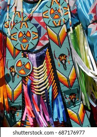 Closeup of native american costume worn by street performer.