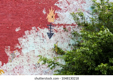 Closeup of Native American mural on brick wall in Tulsa Oklahoma USA circa May 2010