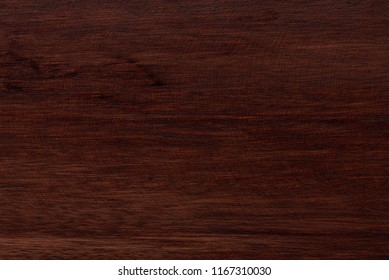 Close-up of natural finished wood surface. Dark brown wooden tetxure