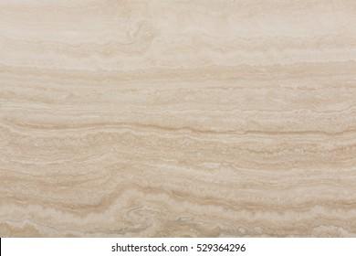 Closeup of natural travertine stone background. High resolution photo.