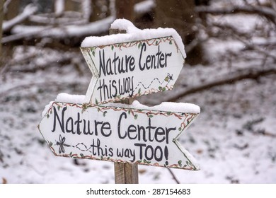 Closeup of Nature Center Signs in light snowfall