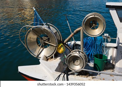 Close-up of net-raising gear on a small inshore fishing boat in Gruissan in Southern France