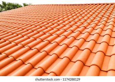 Closeup of new red color clay ceramic roof on building