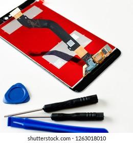 Close-up of new smartphone screen, mobile phone repairing